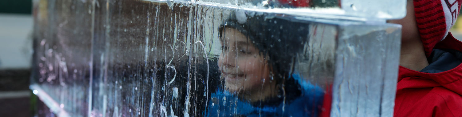 kid looking through ice