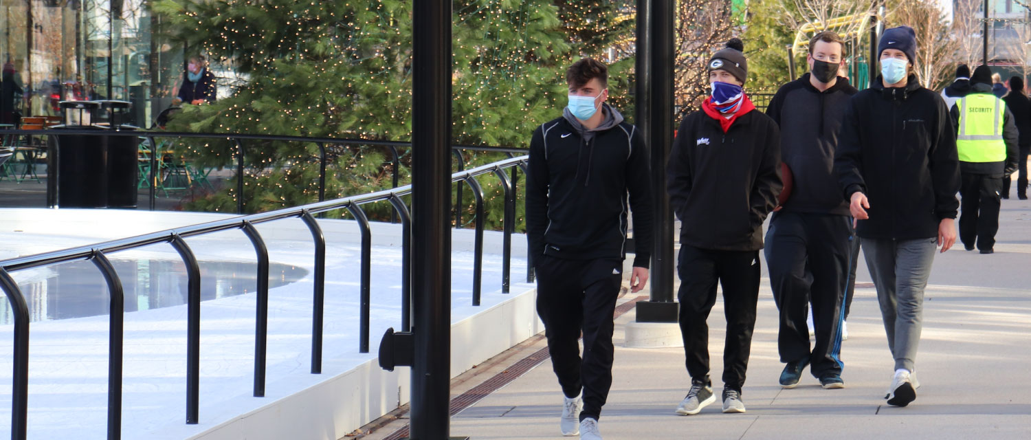 guys walking with masks on